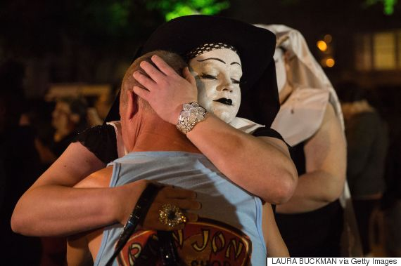 TOPSHOT - A Sister of Perpertual hugs a mourner during a vigil in Dallas, Texas, on June 12, 2016, for victims of the attack at Orlando's Pulse Nightclub in Orlando, Florida. Fifty people died when a gunman allegedly inspired by the Islamic State group opened fire inside a gay nightclub in Florida, in the worst terror attack on US soil since September 11, 2001. / AFP / Laura Buckman        (Photo credit should read LAURA BUCKMAN/AFP/Getty Images)