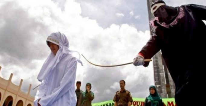 Woman caned in front of jeering crowd in Indonesia for breaking Islamic law