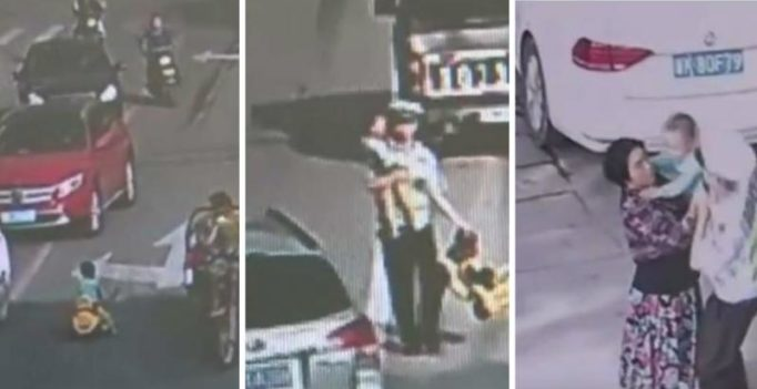 Video: Moment brave cop saves toddler driving toy car on busy street in China