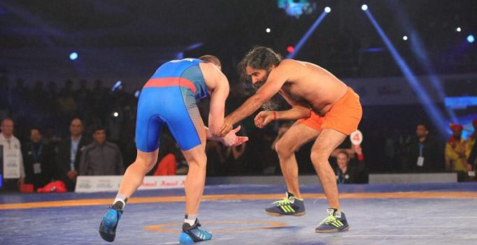 Watch: Baba Ramdev wrestles, beats Olympic medallist 12-0