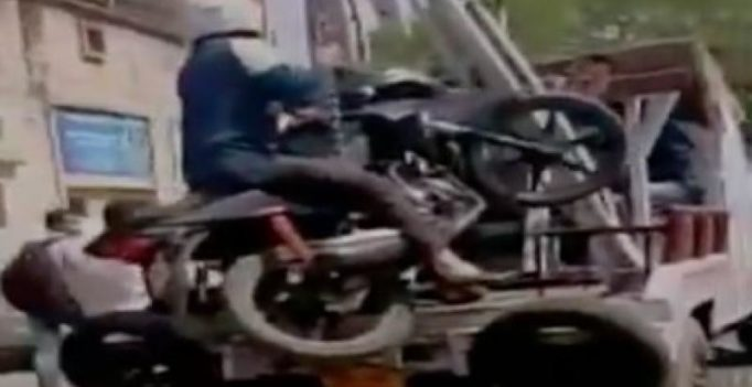 Kanpur man refuses to let go of bike even as traffic police tows it away