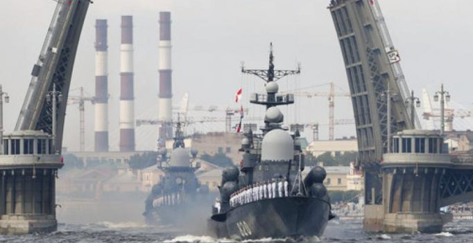 Putin displays Russian navy strength in its first ever parade at Syrian base