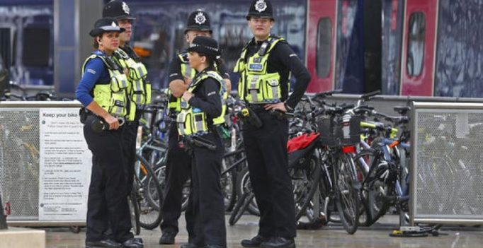 Britain lowers threat level after 2nd arrest in Underground train attack