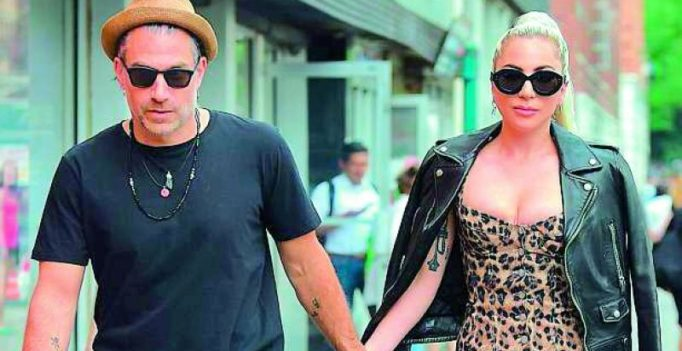 Lady Gaga goes wild in leopard print with fiancé Christian Carino