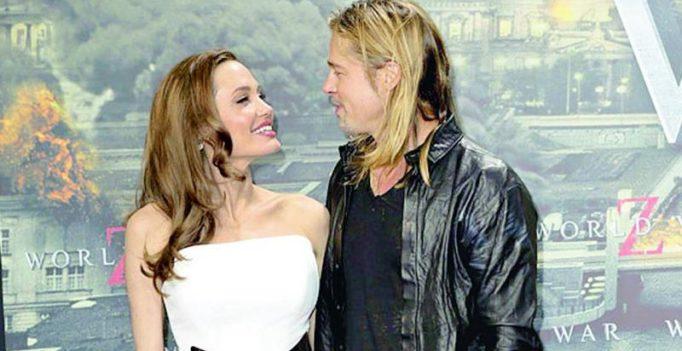 Angelina Jolie plans to adopt, Brad Pitt upset