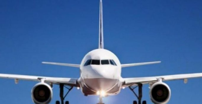 Passenger detained for opening plane's exit door, mistaking it for toilet's